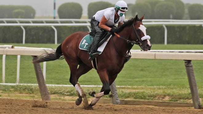 Robin Smullen rides Tiz the Law during a workout at Belmont Park in Elmont, N.Y., on Friday.