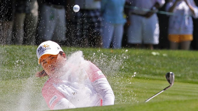 Inbee Park hits out of a bunker to the first tee during the third round of the KPMG Women's PGA Championship at Westchester Country Club June 13, 2015. Park finished the day in first place at 14 under par.