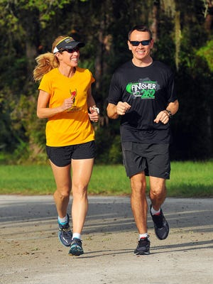 Cheryl Ritter edged out her husband Ron as Space Coast Runners Most Improved Runner of the Year.