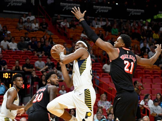 Pacers center Myles Turner (33) drives to the basket