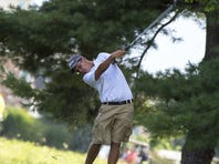 Greencastle's John Williams hits a shot during a recent golf match. He shot 82 to tie for third on Thursday.