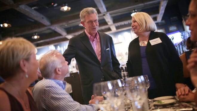 Detroit Free Press Restaurant Critic Sylvia Rector, right, and Bill's owner Bill Roberts talk with guests during the Detroit Free Press Top 10 Takeover dinner series at Bill's in Bloomfield Hills on Tuesday, September 8, 2015.
