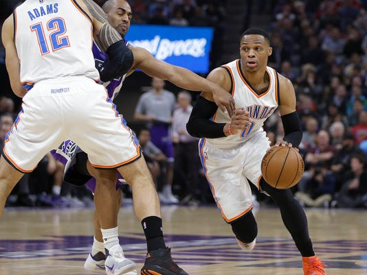 Sacramento Kings guard Arron Afflalo, center, tries to fight through a screen set by Oklahoma City Thunder center Steven Adams, left, while trying to stay with Thunder guard Russell Westbrook during the first quarter of an NBA basketball game in Sacramento, Calif., Wednesday, Nov. 23, 2016. (AP Photo/Rich Pedroncelli