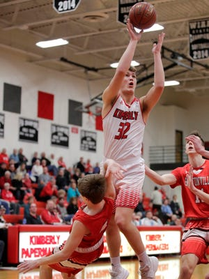 Kimberly's Levi Nienhaus-Borchert goes for a layup during a game against Hortonville last February in Kimberly. Danny Damiani/USA TODAY NETWORK-Wisconsin