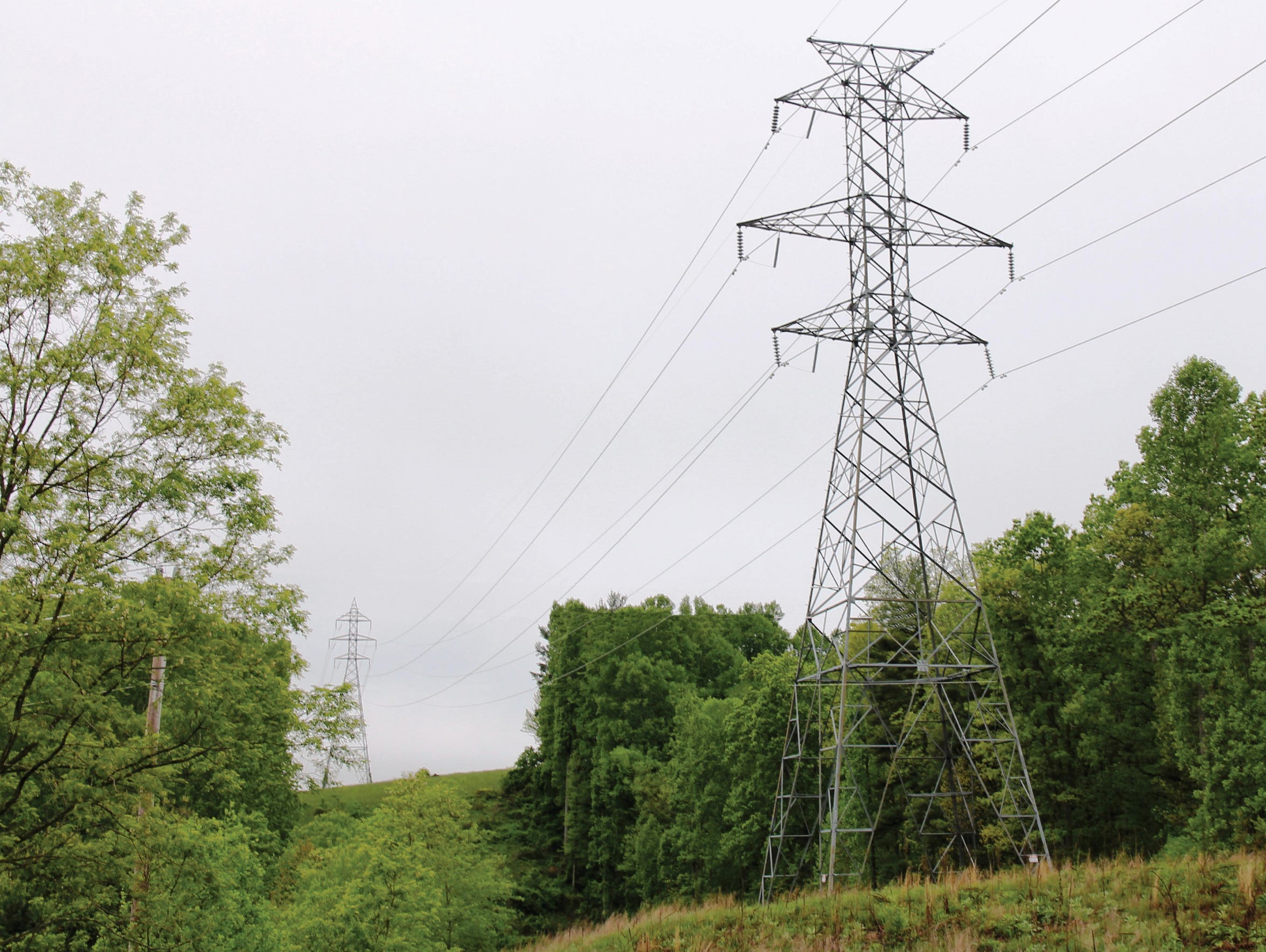 The photograph depicts a typical 230 kV double circuit