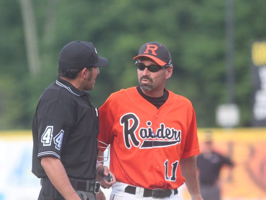 Ryle head coach Pat Roesel talks to an umpire between innings. Ryle beat Dixie Heights 4-0 in the 9th Region championship game May 30, 2013 at University of Cincinnati Medical Center Stadium in Florence.