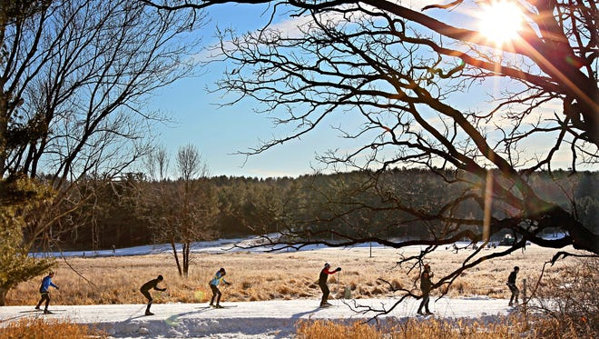 Skiers make their way along the trails at Lapham Peak, a unit of the Kettle Moraine State Forest in Delafield.