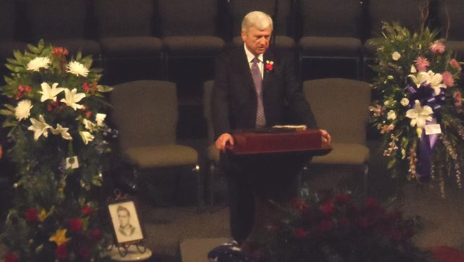 Sen. Gerald Long speaks at the funeral service Friday for his brother, former Rep. Jimmy D. Long Sr.
