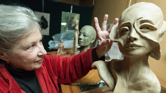 Tomi LaPierre, a sculptor, works on a piece of art in her studio located on Doña Ana Road on Monday, Jan. 23, 2017.