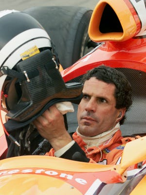 Indy Car driver Roberto Guerrero of San Juan Capistrano Calif. removes his helmet after a practice  run at the Indianapolis Motor Speedway Wednesday May 16 2001. Guerrero qualified for his 16th Indianapolis 500 Sunday but he has the slowest speed in the field and is on the bubble for Sunday's Bump Day. (AP Photo/Tom Strattman)