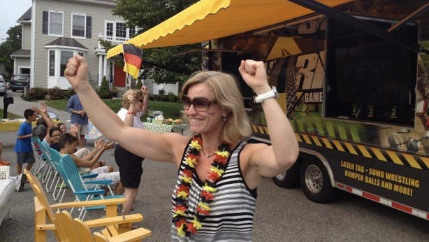 Cologne, Germany, native Andrea Stein celebrates Germany's win in the World Cup Final on Birch Street in Ossining, where neighbors rented a truck with widescreen TVs to watch the game outdoors on Sunday, July, 13, 2014