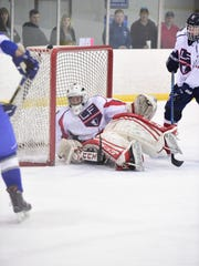 It was a busy night for Livonia Franklin sophomore goalie Will Augustine, who is shown recovering after making one of 38 saves against the Warriors.