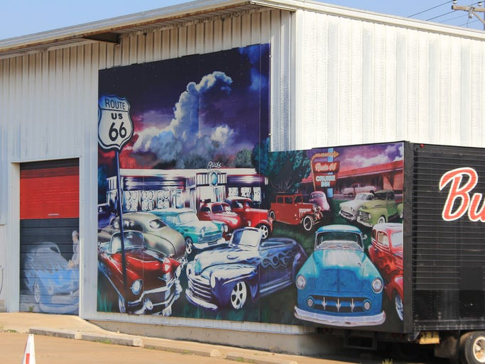 Bud's Tire and Wheel has a Route 66-themed mural on its exterior which tourists often stop to photograph.