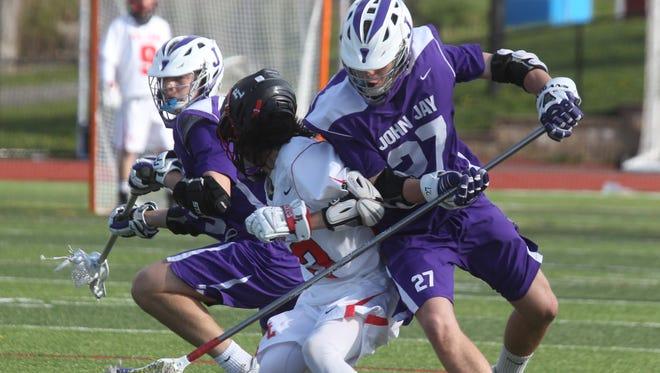 John Jay lacrosse won 12-11 at Fox Lane April 25, 2016.