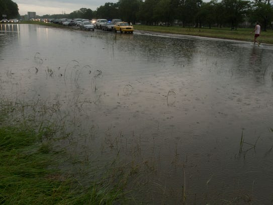 Cars stranded at a flooded section of Interstate 49