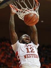 UTEP's Terry Winn slam dunks on a fast break Saturday.