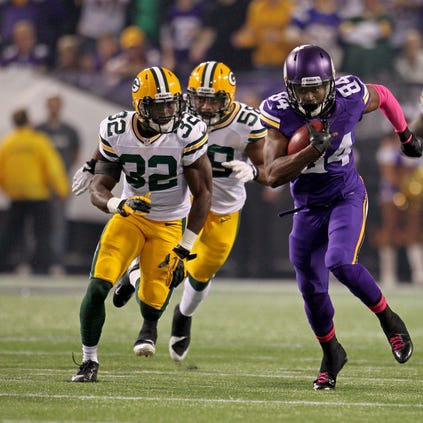 Vikings wide receiver Cordarrelle Patterson (84) returns the opening kickoff for a touchdown during last year's game at the Metrodome.
