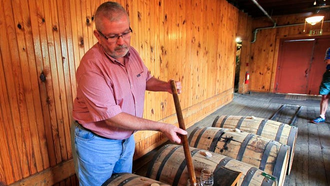 Chris Zaborowski, owner of Westport Whiskey & Wine and The Tasting Room, fills glasses to sample bourbon from Buffalo Trace in Frankfort.  Zaborowski samples and selects bourbon to sell at his shop.June 17, 2015