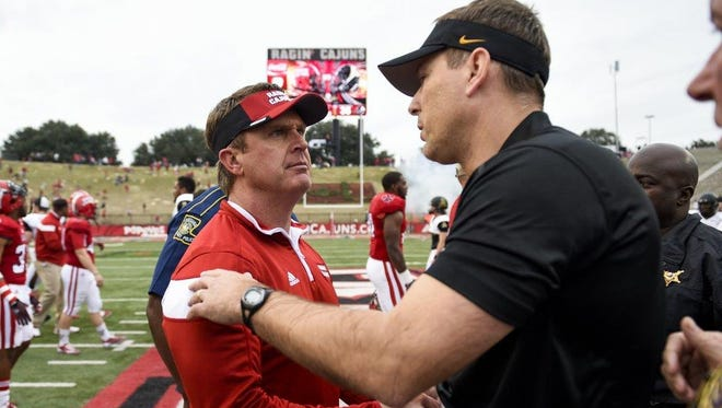 UL coach Mark Hudspeth (left) and Appalachian State coach Scott Satterfield meet when the Mountaineers beat the Cajuns in 2014.