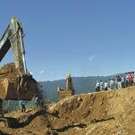 Searchers pull bodies after Myanmar landslide