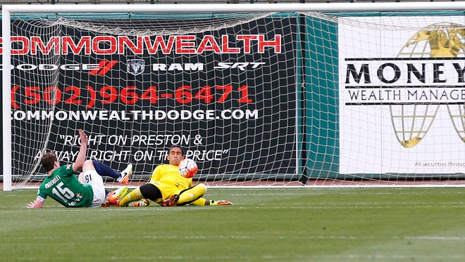 LCFC's goal keeper Greg Ranjitsingh with a diving deflection of St. Louis' Mike Ambersley. 