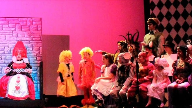 """Members of """"Alice in Wonderland"""" cast 1 include, from front to back, Abigail Winans (Queen of Hearts), Ella Coleman (Duck) Ellie Friedman (Lory), Bridgette Turner (Alice), Ben Zindle (Dormouse), Isis Minni (Cheshire Cat), Maria Foti (Baby), Jenna Patrick (Duchess), Jeannie Sebesta (Caterpillar), Jerry Ciaravino (Gryphon) and Mackinaw Shutt (Mock Turtle)."""