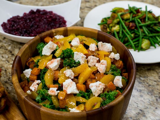 A salad of butternut squash, clementine, and kale topped with goat cheese is pictured amongst other Thanksgiving side dishes at Tony Chachere's Creole Foods, in Opelousas, La., Wednesday, Nov. 4, 2015.