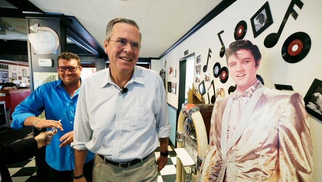 Republican presidential candidate, former Florida Gov. Jeb Bush leaves Gravy's Diner after a meet and greet with local residents Sept. 22 in Cedar Falls.