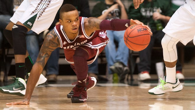 Massachusetts guard Derrick Gordon dives for a loose ball against Ohio in the first half in Athens, Ohio.