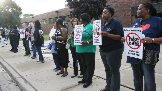 Teachers protest in front of North Division High School in 2015 against measures viewed as a takeover of urban schools.