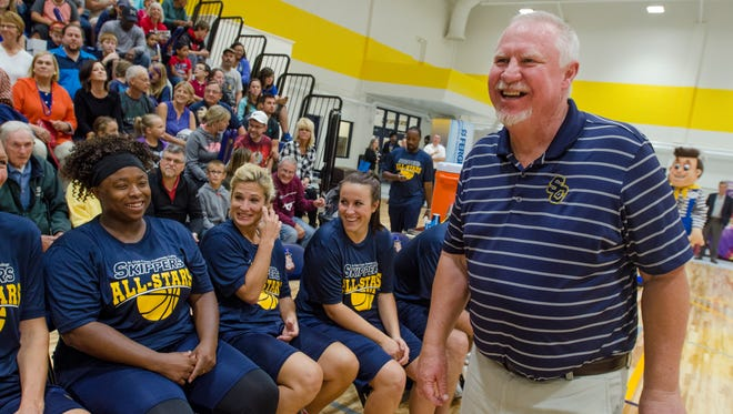Former Times Herald sports editor Jim Whymer handles the honor of head coach for the All-Star team Monday, Oct. 3, during the opening of the Fieldhouse community All-Star game against the Harlem Wizards.