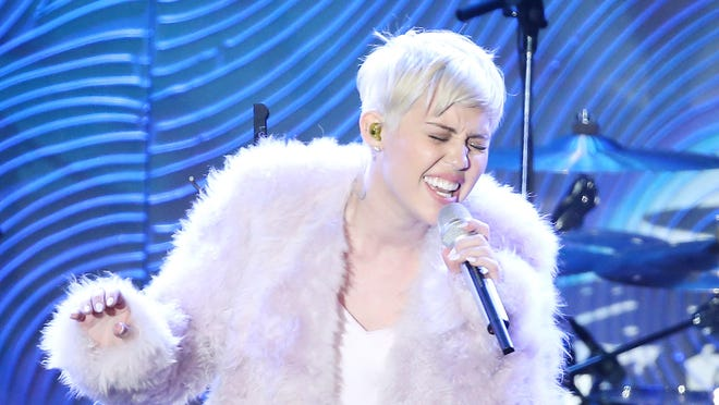 Miley Cyrus performs during Clive Davis' pre-Grammys party on Jan. 25.