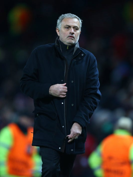 Manchester United head coach Jose Mourinho walks from the pitch after the end of the Champions League round of 16 second leg soccer match between Manchester United and Sevilla, at Old Trafford in Manchester, England, Tuesday, March 13, 2018. Sevilla won the game 2-1 and go through to the quarterfinals .(AP Photo/Dave Thompson)