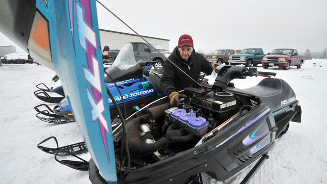 Co-owner Allan Zahrt tunes one of his customers' snowmobiles Thursday afternoon at Pro-Motor Sports near Brokaw.