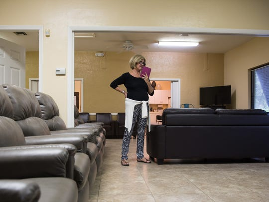 Assistant Director Mindy Johnson takes a call in the vacant Club Room at Care Club of Collier County in Naples on Wednesday, Aug. 31, 2016. Care Club has operated as a day center for adults with Alzheimer's and other memory issues for 24 years, but due to problems with paperwork processing, they have had to temporarily shut their doors to patients.
