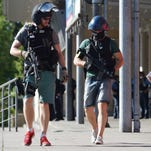 Police leave a cinema in Viernheim, southern Germany, on June 23, 2016. A gunman was shot by police after he took hostages in the complex.
