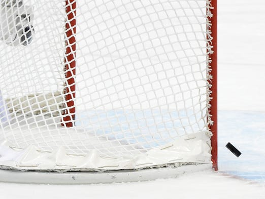 A shot from USA towards an empty Canada net hits the post in the third period.