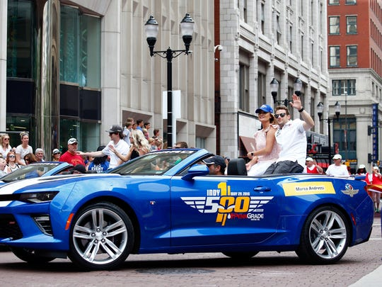Marco Andretti waves during the Indy 500 parade Saturday in Indianapolis.