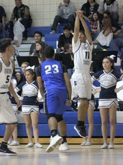 Sal Cruz lets this ball go and shows his form during play against Socorro. He posted five points.