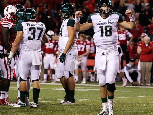 MSU quarterback Connor Cook (18) celebrates after defeating Nebraska 41-28 on Nov. 16, 2013 at Memorial Stadium in Lincoln, Neb. The Spartans went on to win the Big Ten title and the Rose Bowl that season.