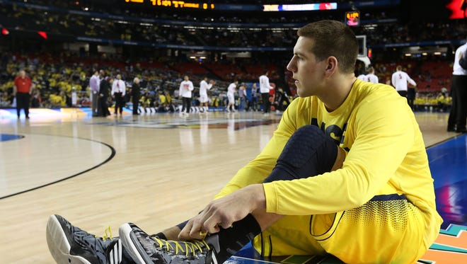 FILE - Mitch McGary #4 of the Michigan Wolverines sits on the court during warm ups against the Louisville Cardinals during the 2013 NCAA Men's Final Four Championship at the Georgia Dome on April 8, 2013 in Atlanta, Georgia.