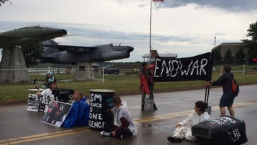Watch: Anti-drone protesters block road outside Air National Guard Base