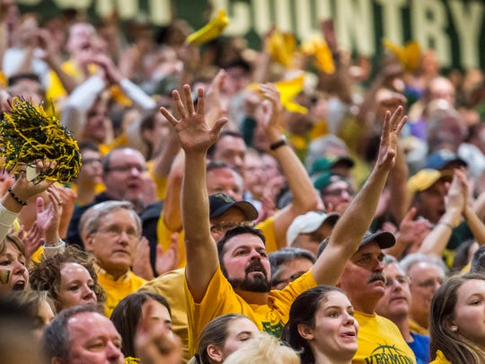 Fans react to a series of free throws that cemented