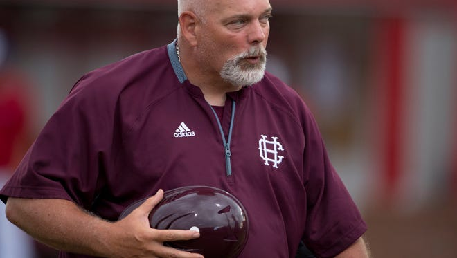 Henderson County Asst. Coach J.D. Arndt heads to the dugout before their game against Christian County in the Second Region semifinal baseball tournament at Christian County High School in Hopkinsville, Ky., Wednesday evening.