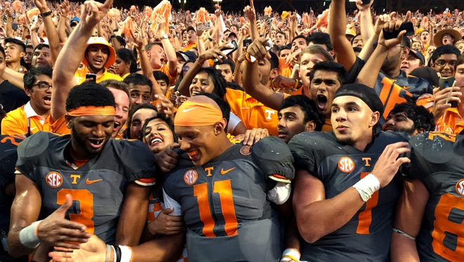 Tennessee wide receiver Josh Malone (3), quarterback Joshua Dobbs (11) and running back Jalen Hurd (1) celebrate with fans after defeating Florida 38-28 at Neyland Stadium on Saturday, Sept. 24, 2016.