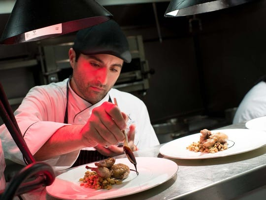Chef Nick Marino puts the finishing touches on a dish