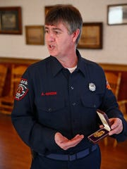 Long Branch Fire Department historian Arthur T. Green II holds his uncle Edward J. Miller's fire chief badge from 1919. Recently a 1902 Long Branch Fire Chief's badge ended up on E-Bay.
