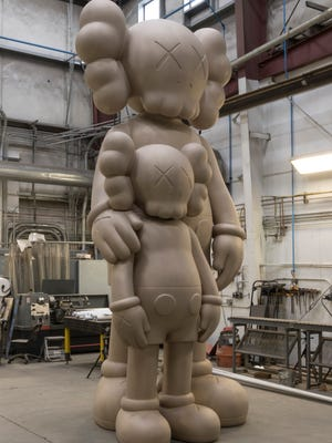 "The statue ""Waiting"" by noted contemporary artist Kaws will soon be placed at the south entrance of the One Campus Martius building in downtown Detroit. It will have a black patina when finished."
