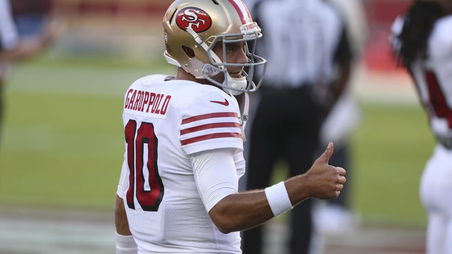 San Francisco 49ers quarterback Jimmy Garoppolo warms up before an NFL football game against the Los Angeles Rams in Santa Clara, Calif., on Oct. 18. The 49ers QB played against his former team in the New England Patriots for the first time since being traded in 2017.
