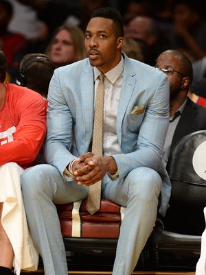 Houston Rockets center Dwight Howard on the bench in the first half of the game against the Los Angeles Lakers.